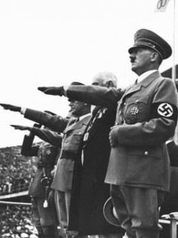 Hitler salutes the Olympic Flag - Berlin 1936. This Olympic games was all about politics.