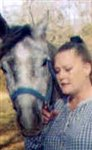 "The author and her beloved Arabian stallion ""Gayraff Rhosabi"" (""Gay"") in 2001"