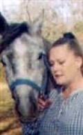 "The author and her beloved Arabian stallion ""Gayraff Rhosabi"" (""Gay"") in 2001"