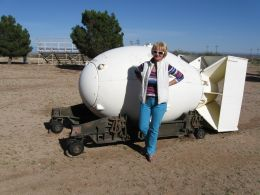 My wife Bella posing next to a model of an Atomic Bomb at the U.S Army White Sands Missile Museum in New Mexico.