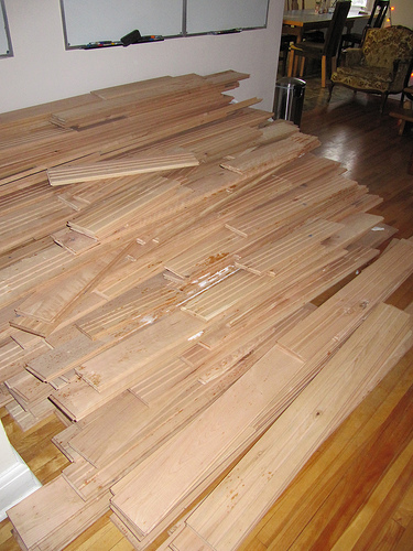 Stacked cedar and cherry wood prior to being used for writing desks.