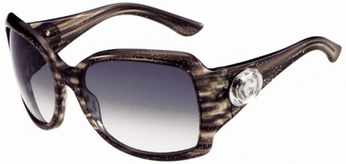 2010 GUCCI Sunglasses with the glitter black frame.