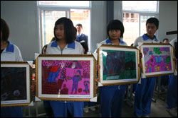 Haitians were not the only ones, here some Chinese students showcase paintings that were created shortly after their earthquake - paintings expressing feelings of deep pain, fear and loss.