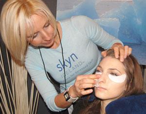 Applying Skyn Iceland Hydro Firming Cool Eye Gels Backstage Beauty at Mercedes-Benz Fashion Week Fall 2010 .skyniceland.com