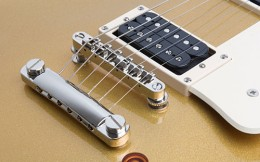 Gibson Les Paul with a Tune-o-Matic bridge and a stopbar tailpiece, strung normally.