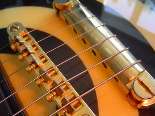 A guitar strung using the wrap-over method.