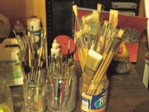 Store your paint brushes according to type and size, bristles up, in clear condiment jars!