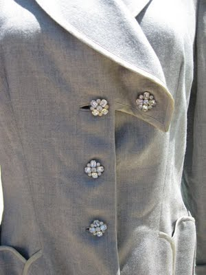 vintage 40s Lilli Ann soft grey jacket with rhinestone buttons.  See related links for more information.
