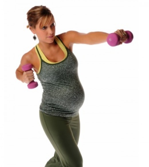 It's better to sit while weight training during pregnancy to prevent peripheral pooling of blood and muscle strain.