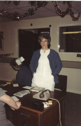 a staff nurse back in the good old days - note the cigarettes and ashtray at the nurse's station!