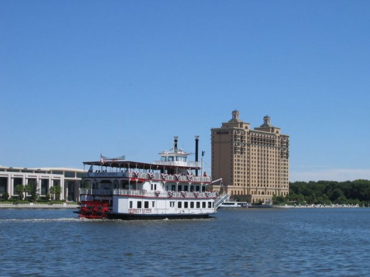 The riverboat Georgia Queen cruising down the Savannah River past the Savannah International Trade and Conference Center on Hutchinson Island.