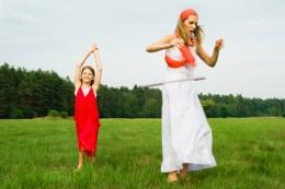 mom with kid having fun -- hoola hoops