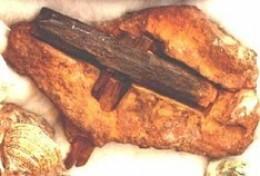 iron hammer found embedded in sandstone