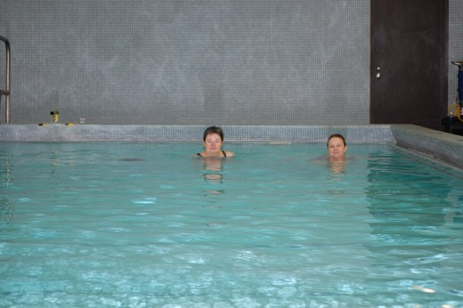 My friend Cindy and me in my clinic's heated pool