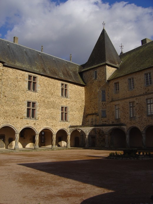 Rochechouart castle courtyard is famous for its twisted columns.