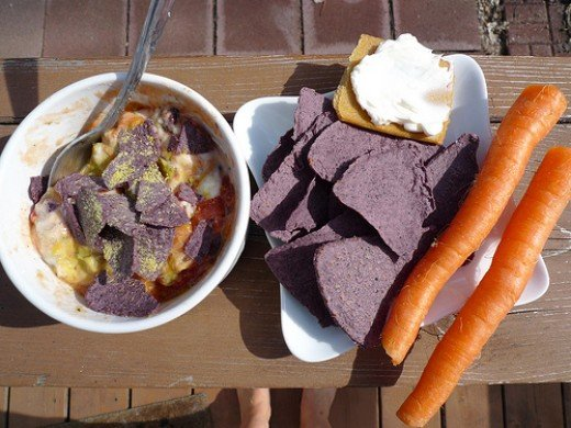 Quick Mexi dip, served with a baked tortilla chips and some carrots.