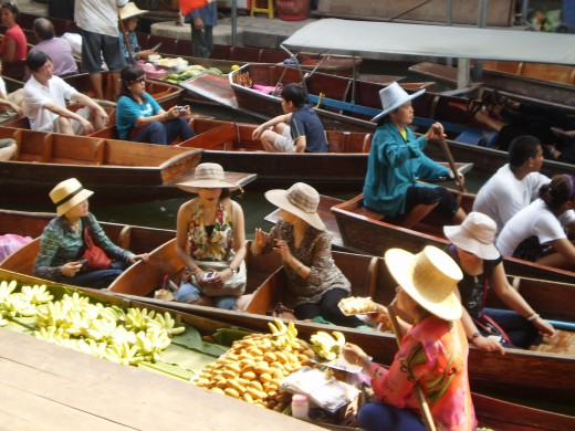 Busy floating market located about 1.5 hours from Bangkok