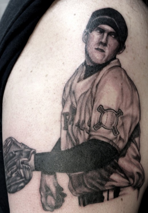 Love the colours in this baseball tattoo plus the look of determination in