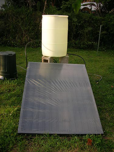 "Composed of a 55-gal. drum, plastic irrigation tubing, and a piece of plywood. It is designed as a ""thermosiphon unit"" meaning that no pump is required to move the water, natural convection currents should do the trick!"