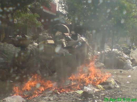 Air pollution due to fire in the collected Garbage , by a burning cigarette,