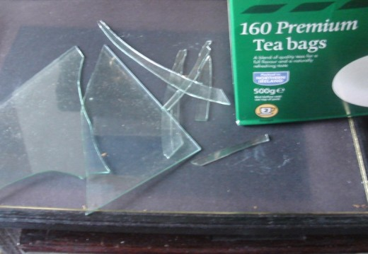 Find a box that has a lid and can hold the broken glass.