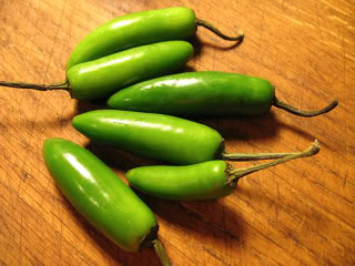 Serrano Peppers are similar in shape and size to Jalapeno Peppers...but they are progressively hotter rating 8000-22,000 on the Scoville scale.