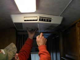 Remove AC ceiling assembly to access AC condenser fan