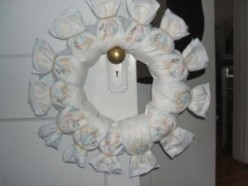 Continue to wrap the diapers around the wreath base until the entire wreath is covered.  Try to get the diapers as close together as possible so that the wreath base is not showing.