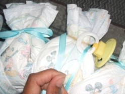 Add pacifiers, bottles, socks, baby washcloths, bibs, rattles, teething rings, infant spoons and forks, etc.