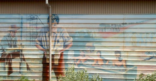 Miners on the Side of Shed with Downpipe. Tennant Creek, NT.