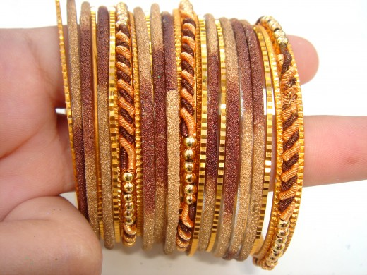 These thin bangles look great when they are worn together.  Three or more.