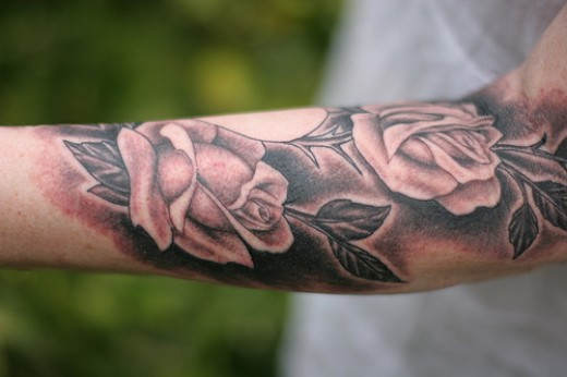 I guess I was wrong about guys getting a black rose tattoo and I must admit this arm tattoo is pretty stunning.