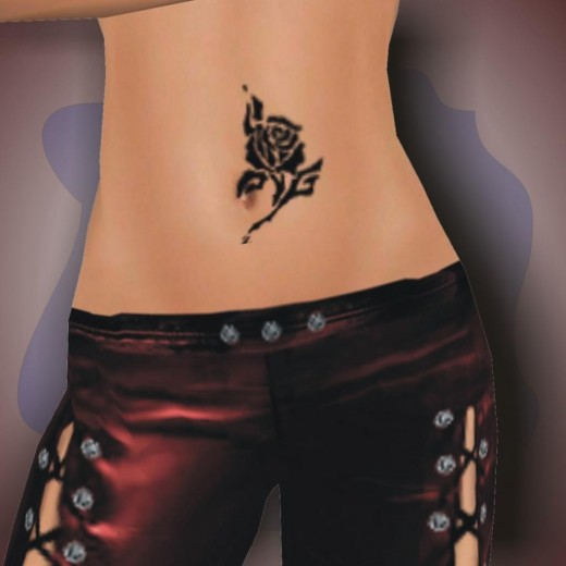 Nice lil belly black rose tattoo right on the belly, well I think it's the belly as I am sure that's a lil belly button I see !