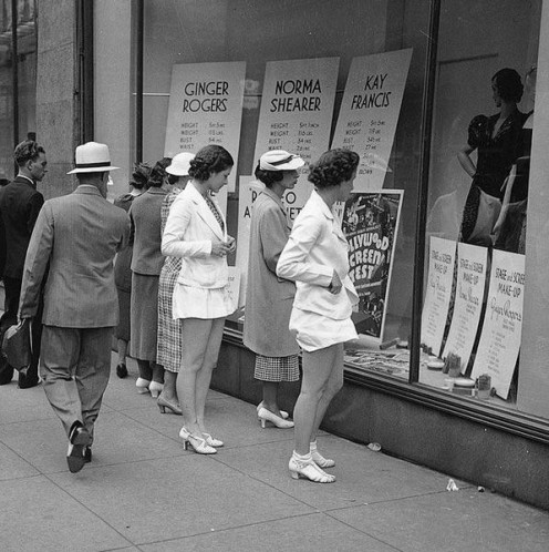 1937, Toronto: Window shopping at Simpsons department store.