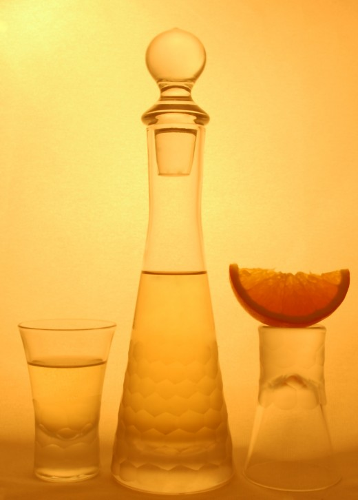 Shot glasses with a slice of orange from Dreamstime.com
