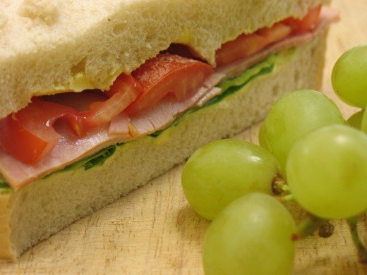 Ham and Tomato Sandwich with Grapes from Dreamstime.com