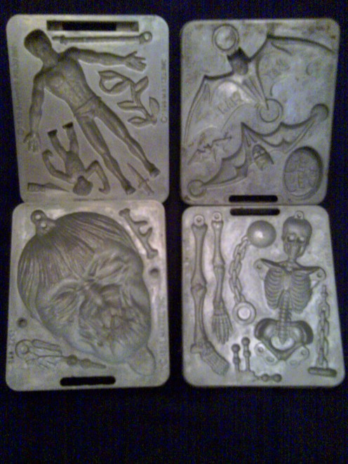 Top left is the Tarzan mold, top right the Batman mold, lower left the shrunken head mold, and lower right the skeleton mold. All were sold on cards like those just above. These are from my collection.