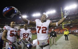 New York Giants' Osi Umenyiora (72) celebrates with teammates Bryan Kehl (53) and Domenik Hixon (87) after after the Giants defeated the Washington Redskins 45-12 in an NFL football game, Monday, Dec. 21, 2009, in Landover, Md. (AP Photo/Rob Carr)