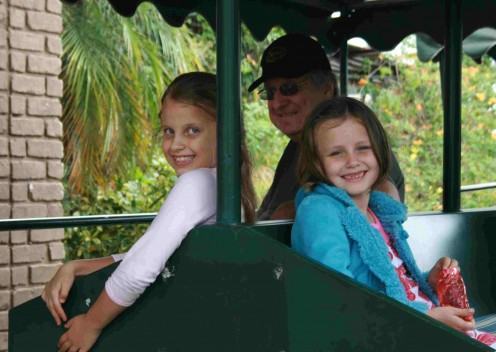 "Caitlin and her best friend Rachael on the ""tractor train"". The old guy in the background is me."