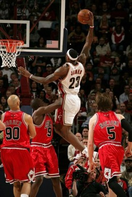 Lebron James doing his usual power dunk that is virtually unstoppable due to his strength and power