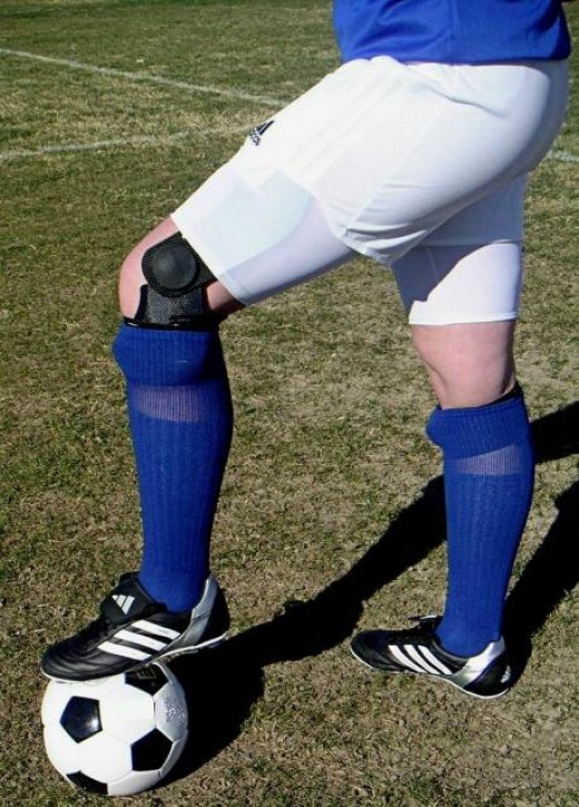 Football player wearing a knee brace