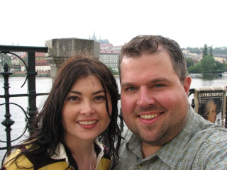 Heidi Ruby Miller and Jason Jack Miller after a rain storm on Charles Bridge in Prague.
