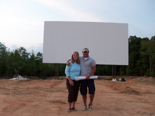 John and Kristina Heidel in front of their completed screen at the Goochland Drive-In Theater