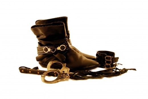 Leather, cuffs, whips, boots, they all go together.