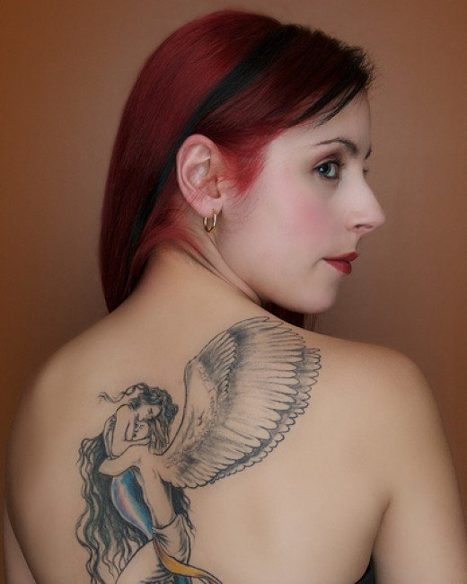An angel tattoo on a redhead angel, jeeez I have died and gone to heaven !