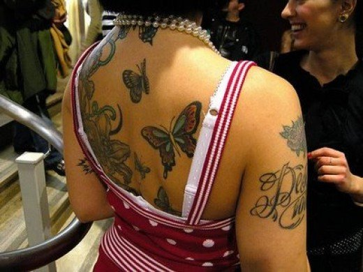 Nice lower back tribal tattoo and deff one of my fav ladies tattoos,