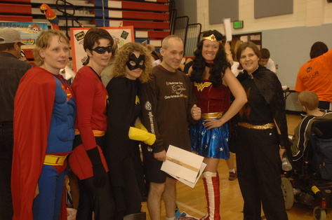 Dr. Kevin Murphy poses with a team of therapists in disguise