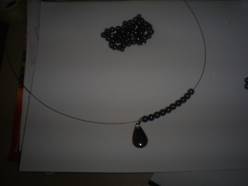I added the first ten magnetite beads and then I added the pendant. (Photo By Sweetiepie On Hubpages)