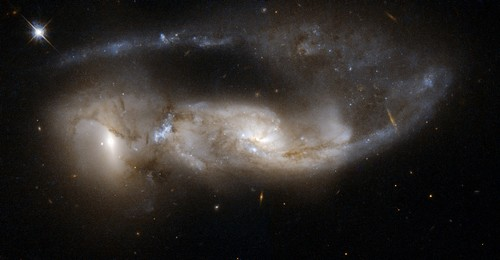 One reason why biblical literalists are wrong in interpreting the Bible and claiming a young universe. Hubble photo of NGC 6621 and 6622, approximately 100 million years after their closest approach.