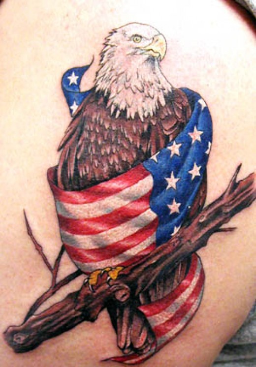 of America just wrapped in the American Flag, this is a stunning tattoo.